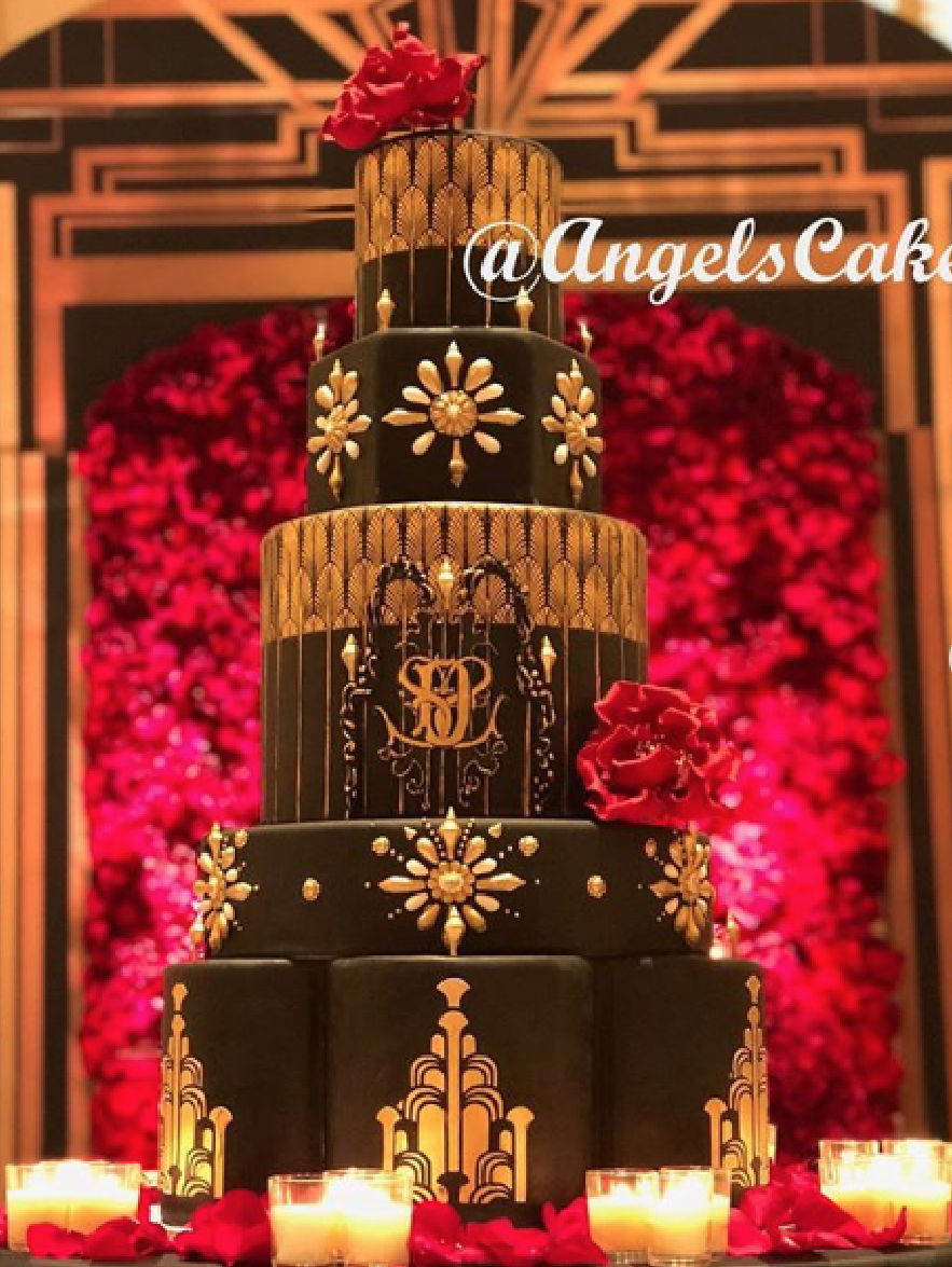 Ornate black fondant wedding cake with gold