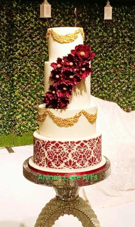 White fondant cake with Burgundy sugar flowers
