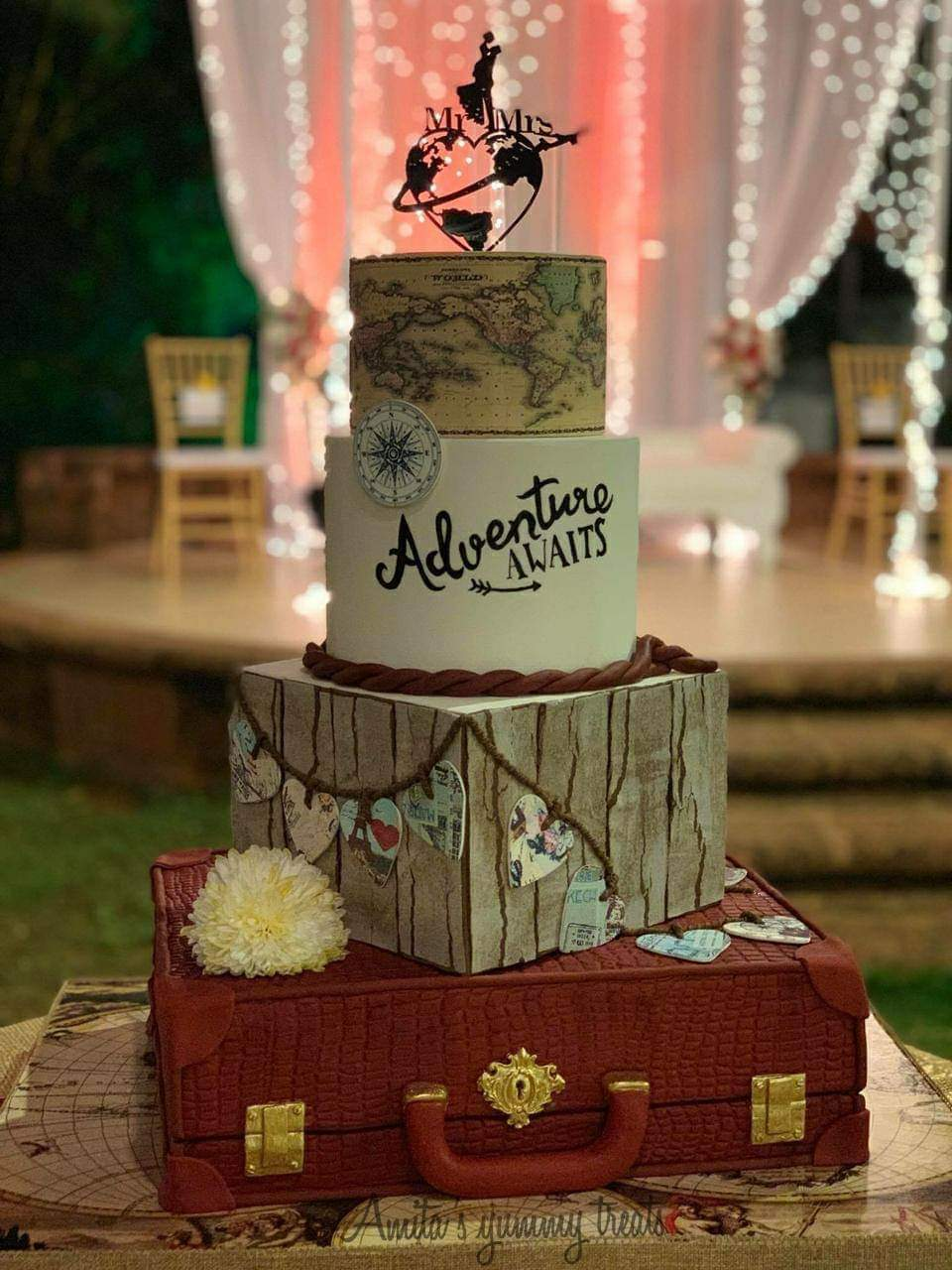 Suitcase shaped traveling fondant cake