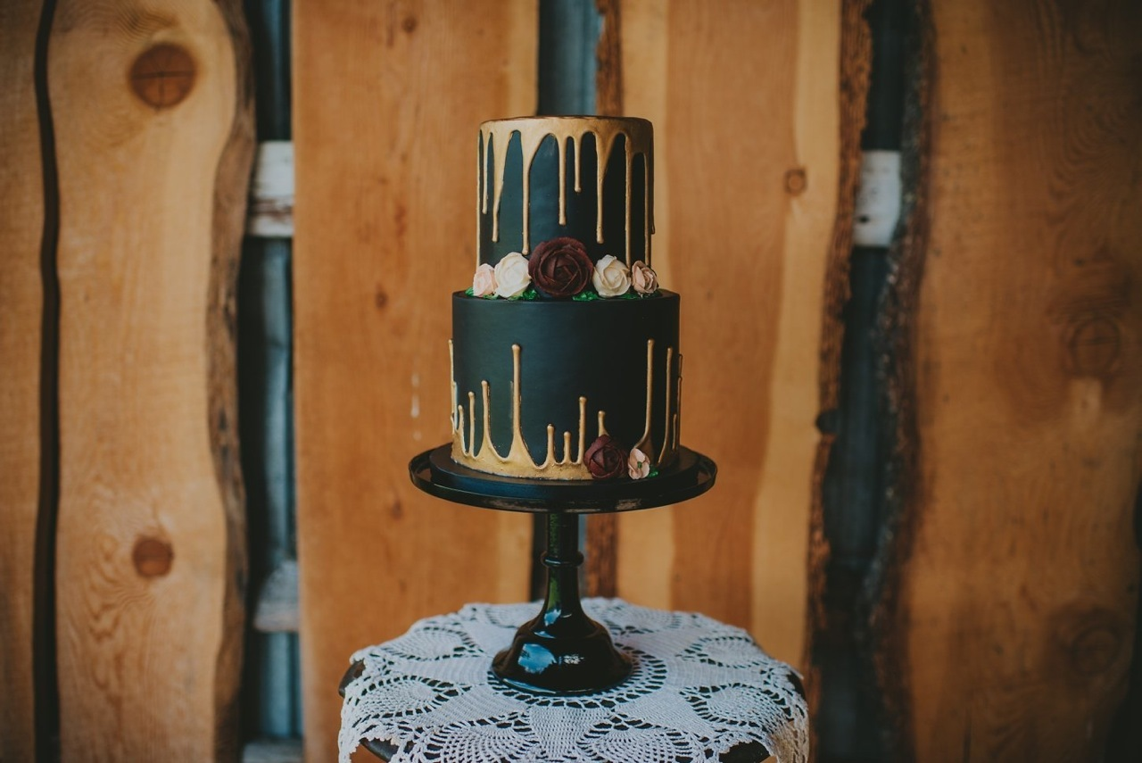 Black with gold drip wedding cake