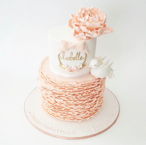 Peach and white ruffle fondant cake