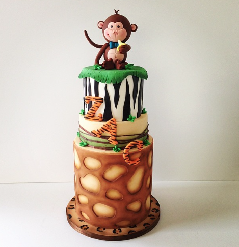 Safari themed birthday cake with monkey topper