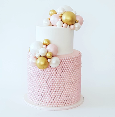Pink and white sugar pearl birthday girl cake
