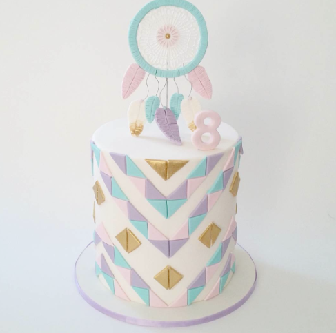 Pastel colored boho fondant birthday cake