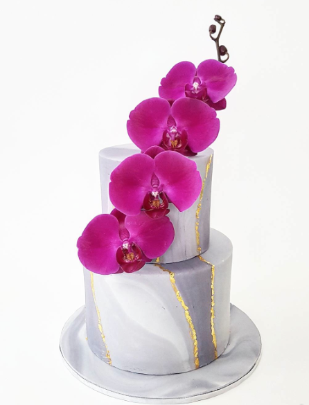 Gray  marbled wedding cake with purple sugar flowers