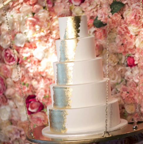 White wedding cake with silver and gold sparkle