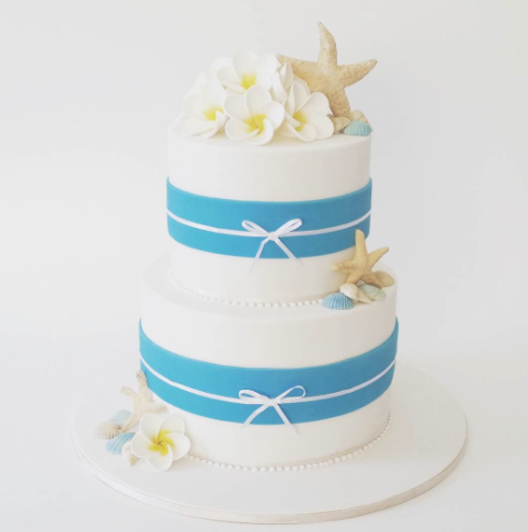 Blue and white beach themed wedding cake