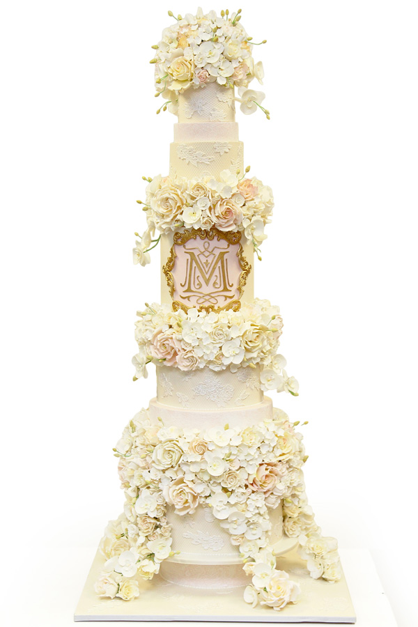 White and light pink fondant high tiered wedding cake for actor Tracy Morgan