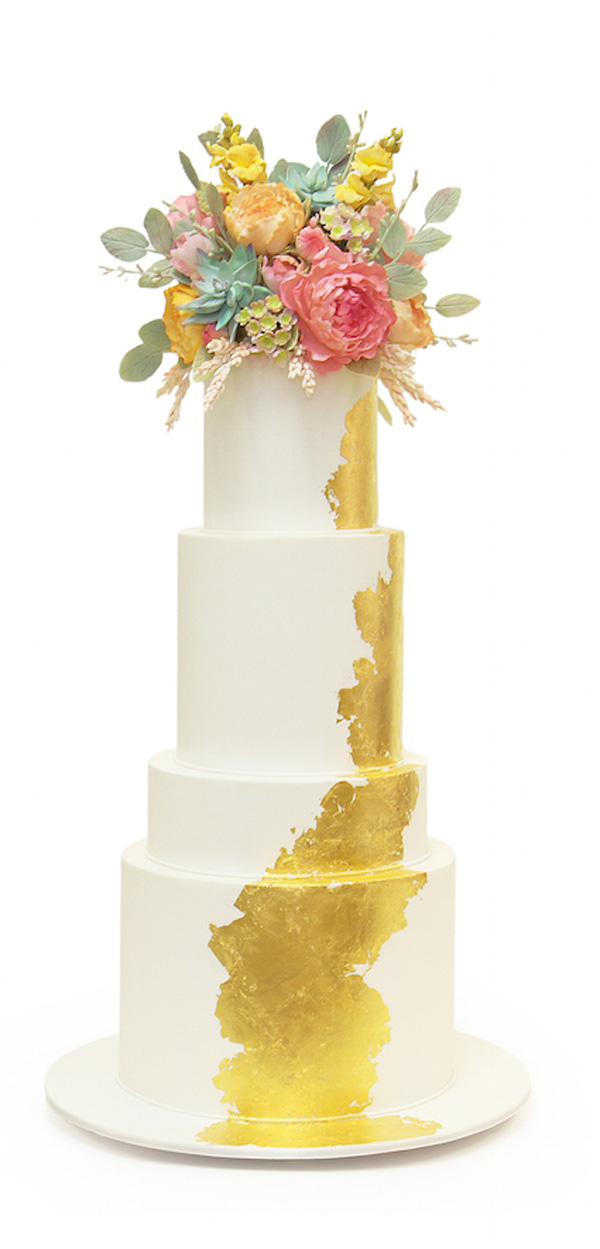White fondant wedding cake with gold