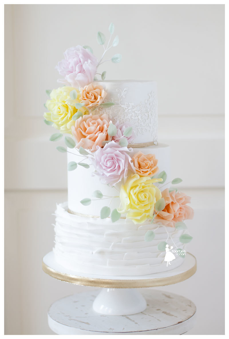 White ruffle fondant wedding with pastel gum paste sugar flowers
