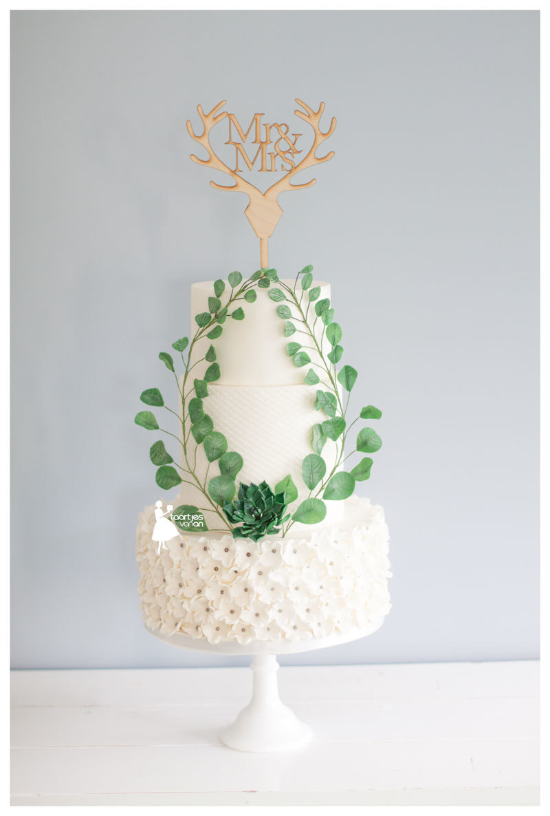 Quilted White fondant wedding with green gum paste wreath