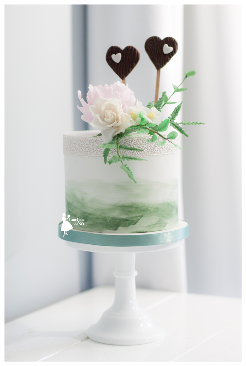 Mini green and white watercolor wedding cake