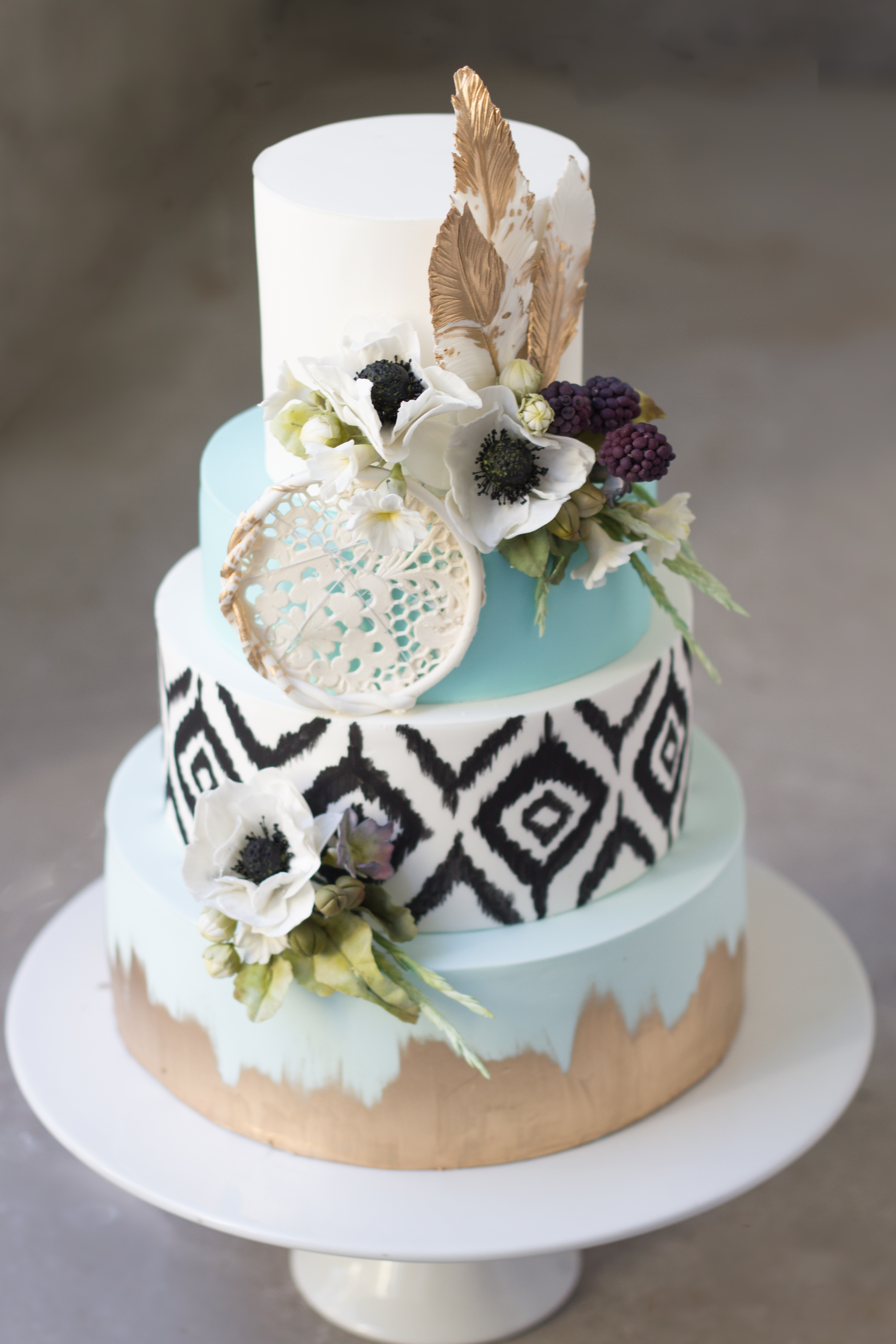 Tribal Southwest patterned fondant wedding with feathers