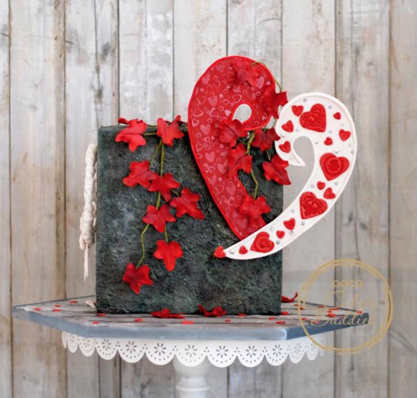 Black fondant cake with floating red hears