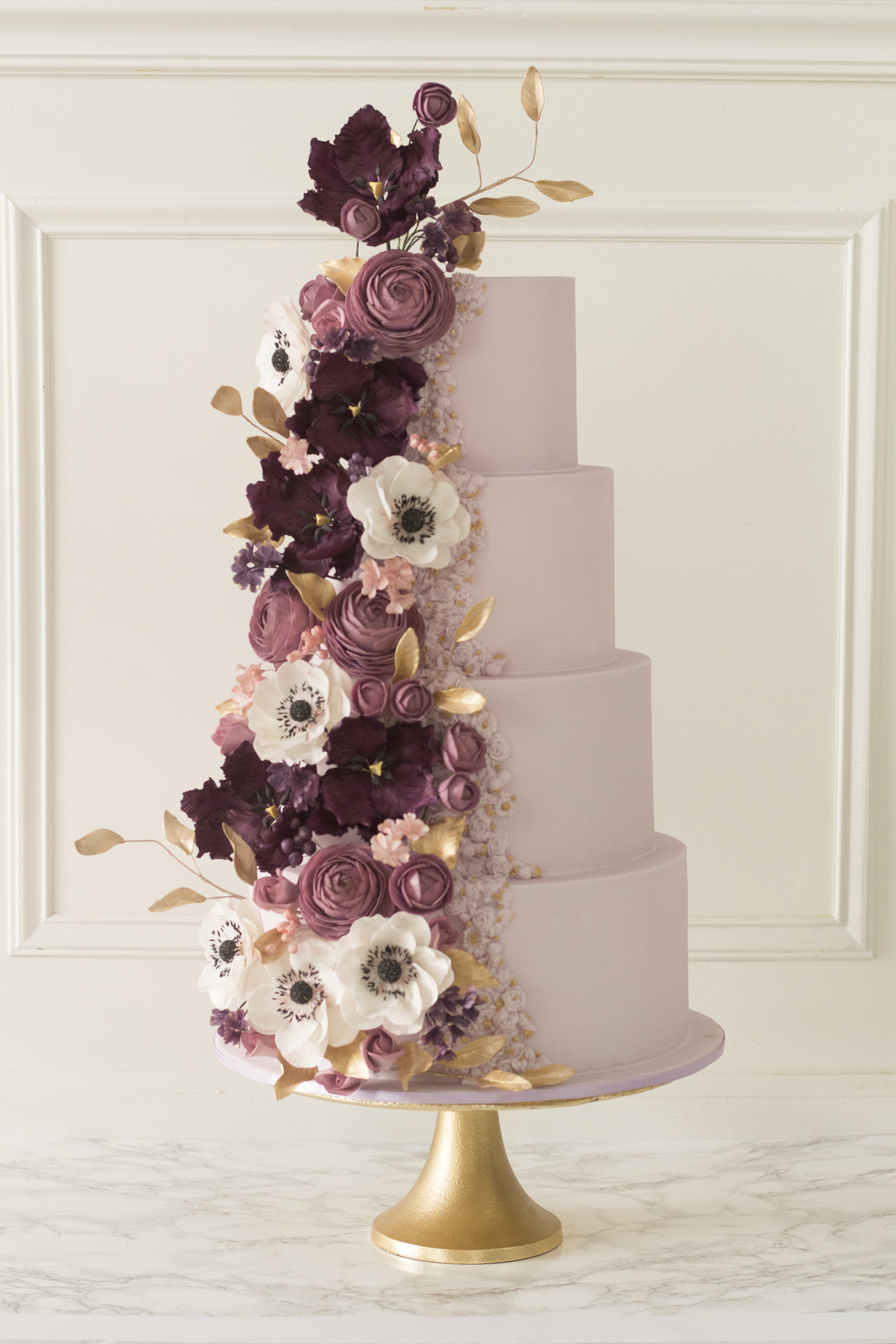 Baby Pink fondant wedding cake with cascading shade of pink sugar flowers