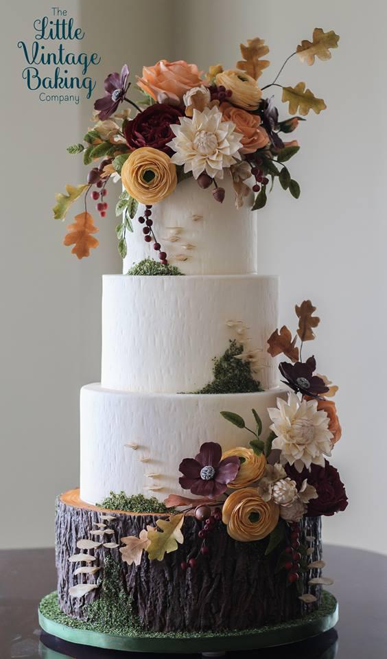 Rustic white wedding cake with exposed bark