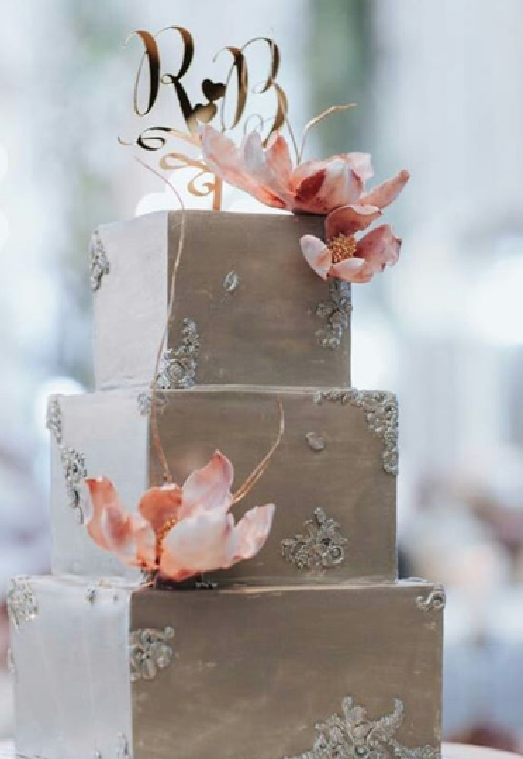 Taupe fondant wedding cake with pink flowers
