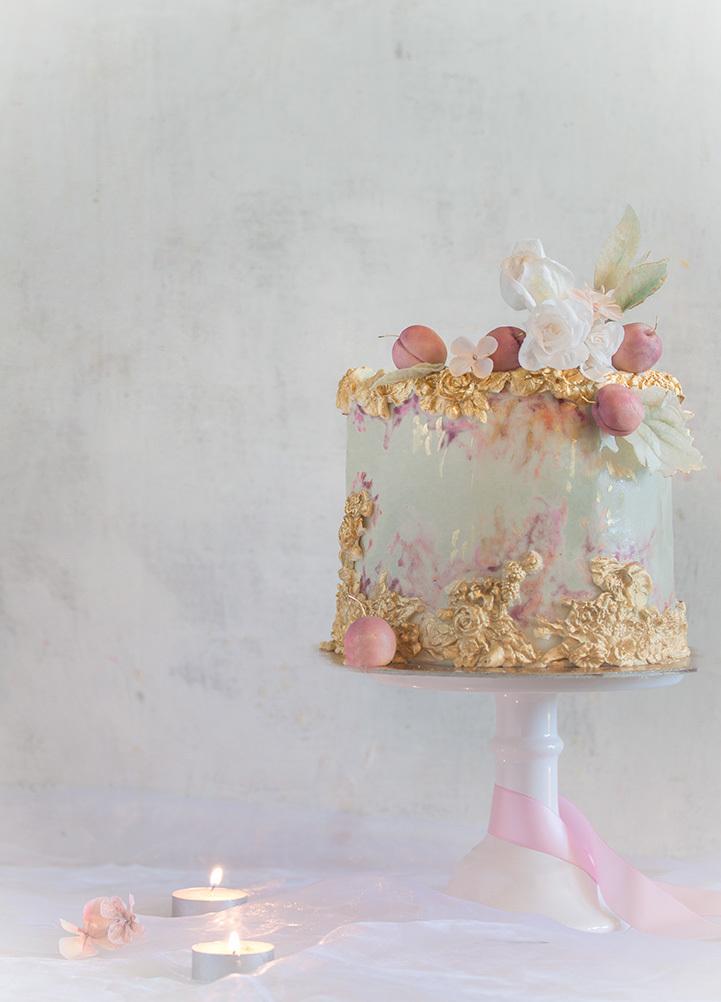 Pastel green and gold sparkle fondant wedding cake