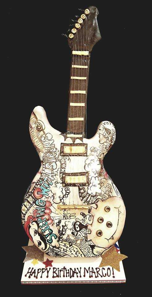 Sculpted fondant guitar birthday cake