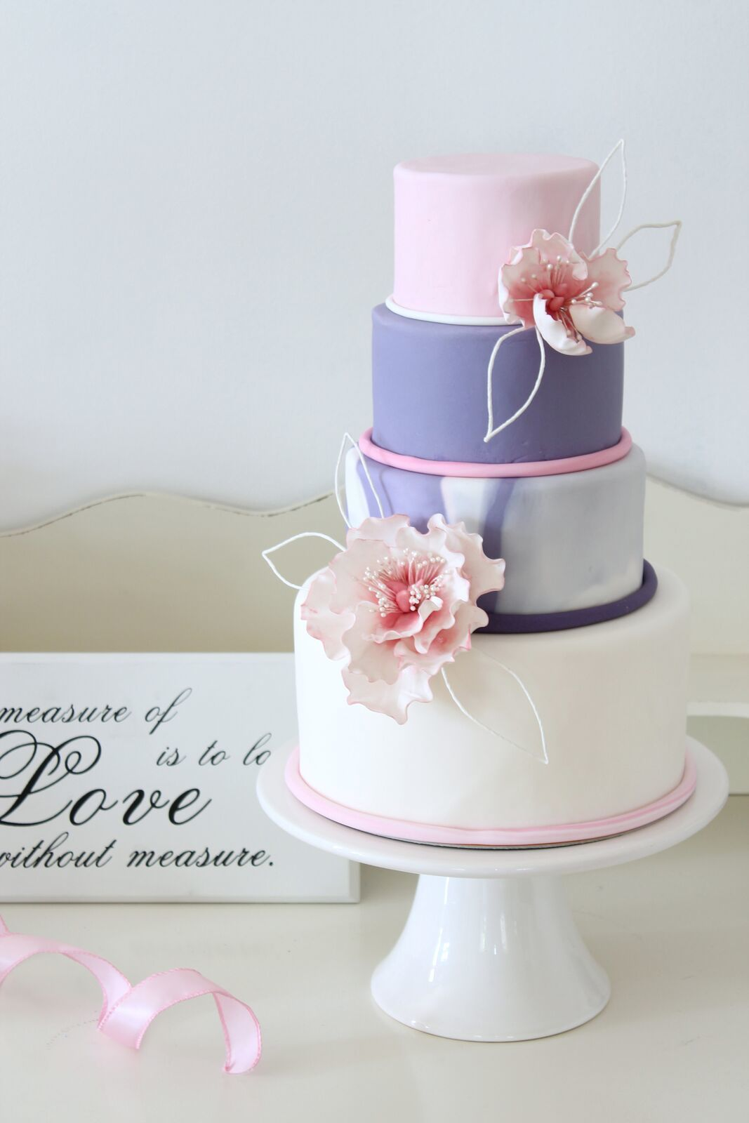 Lavender and baby pink fondant wedding cake