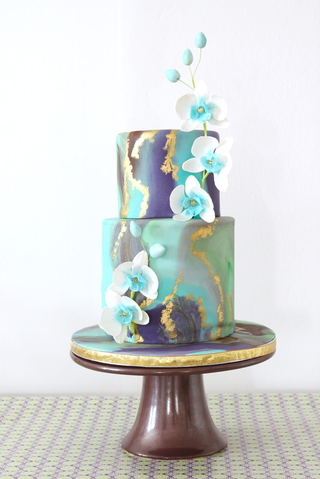 Purple and turquoise marbled fondant wedding cake