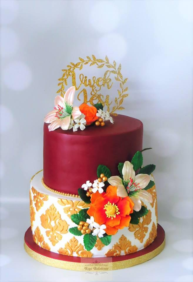 Burgundy fondant wedding cake with damask pattern