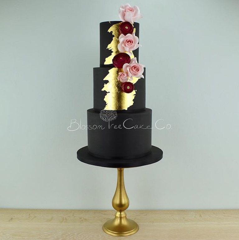 All black fondant wedding cake with gold leaf