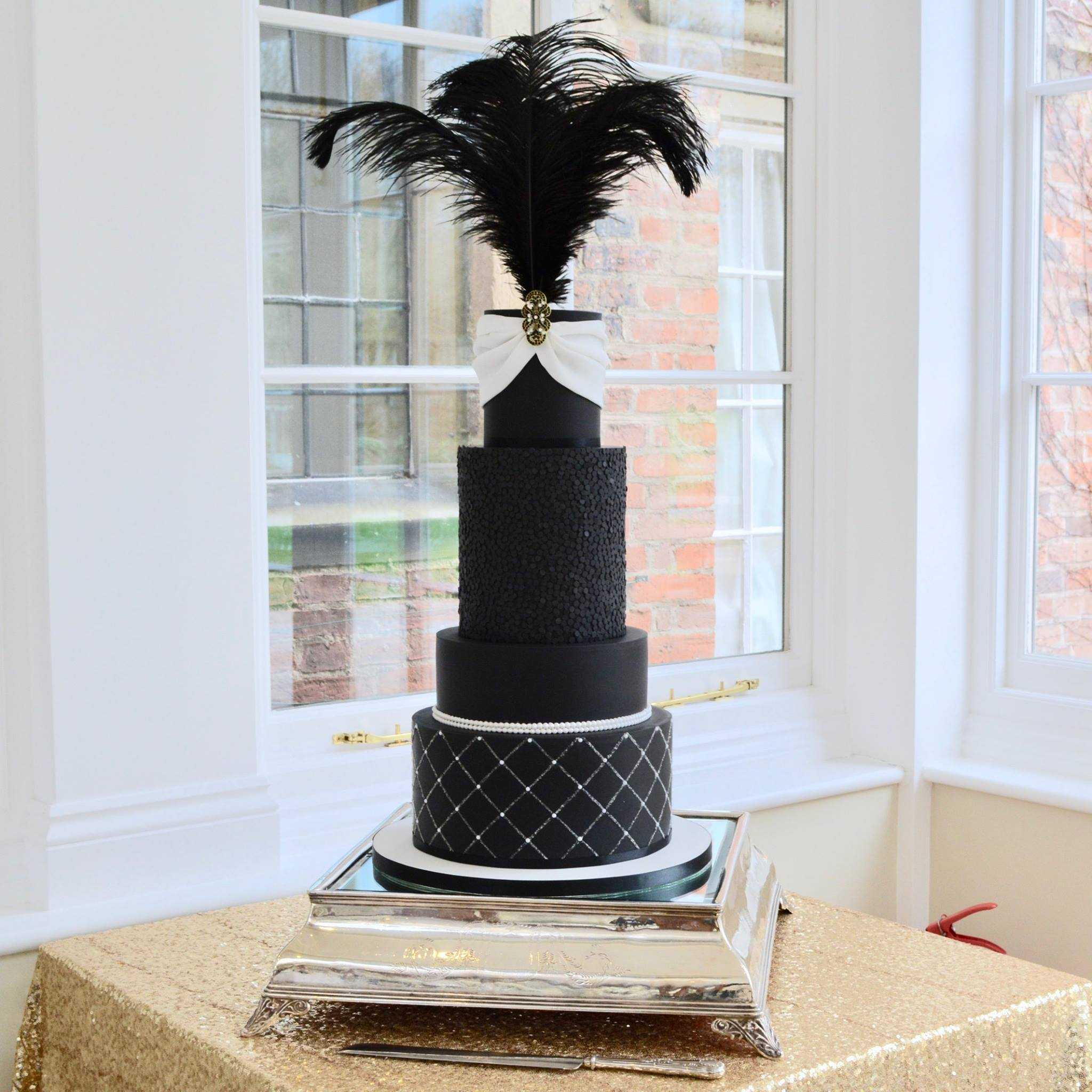 All Black fondant wedding cake with feathers
