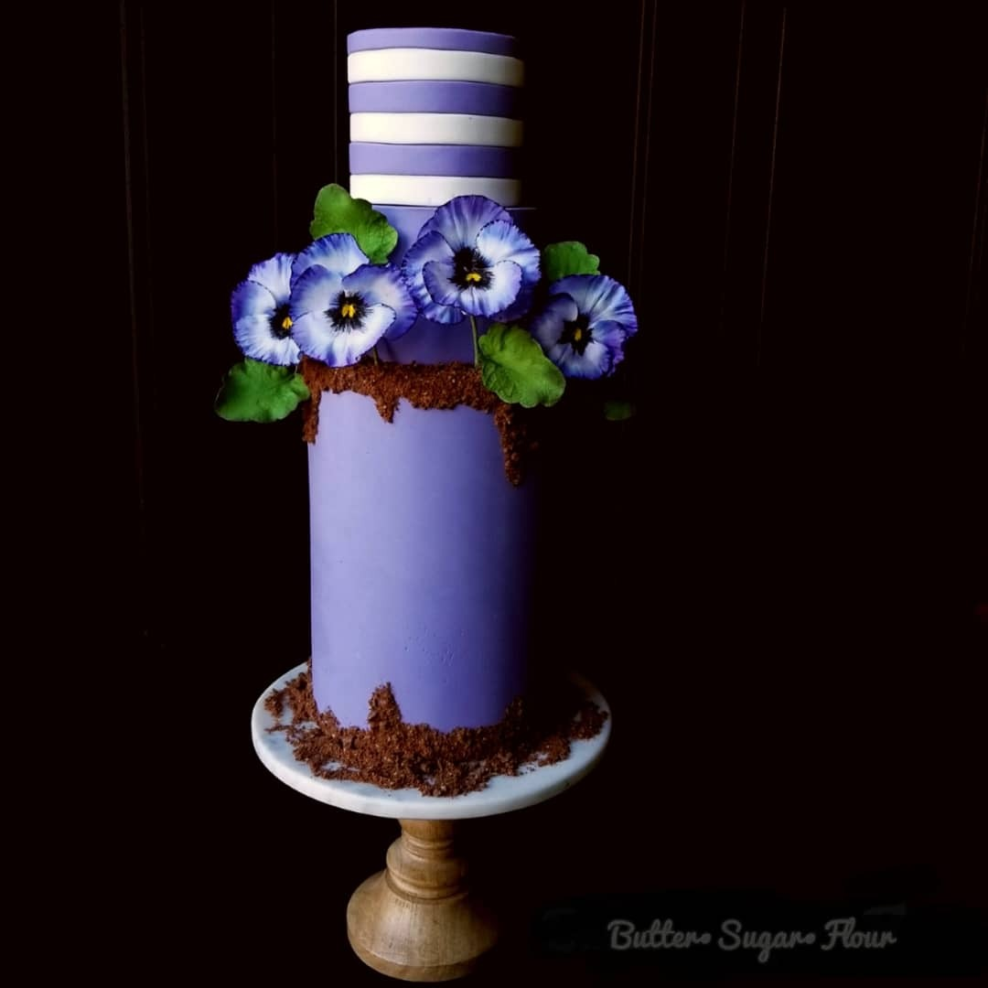 Purple and white striped fondant wedding cake