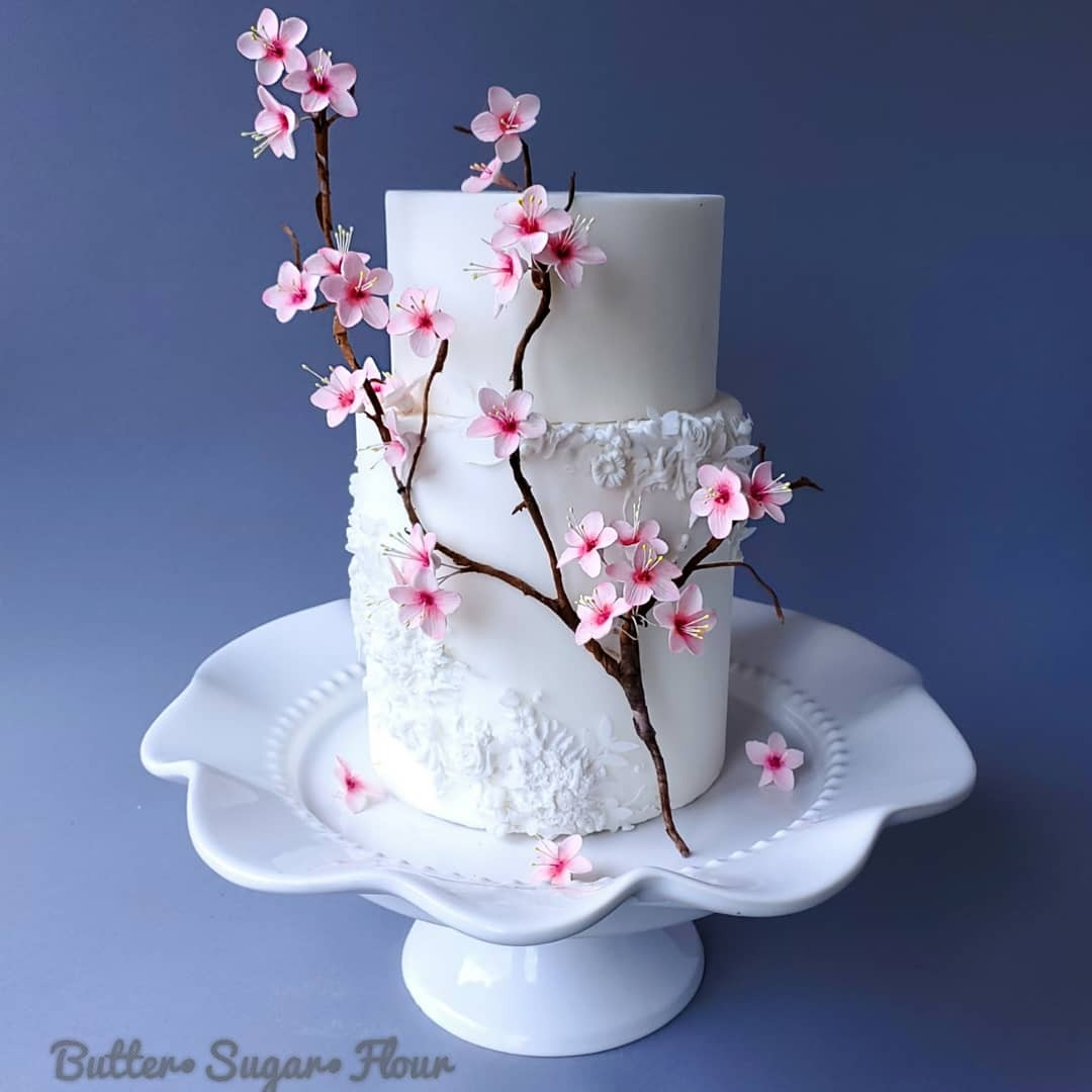 White fondant cake with cherry blossoms
