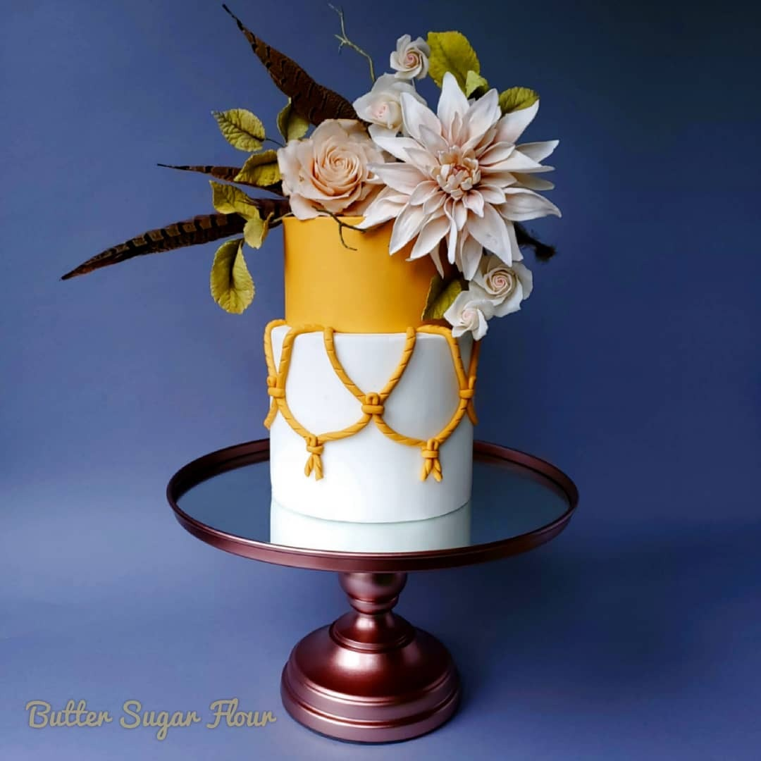 Gold shimmer and white fondant wedding cake