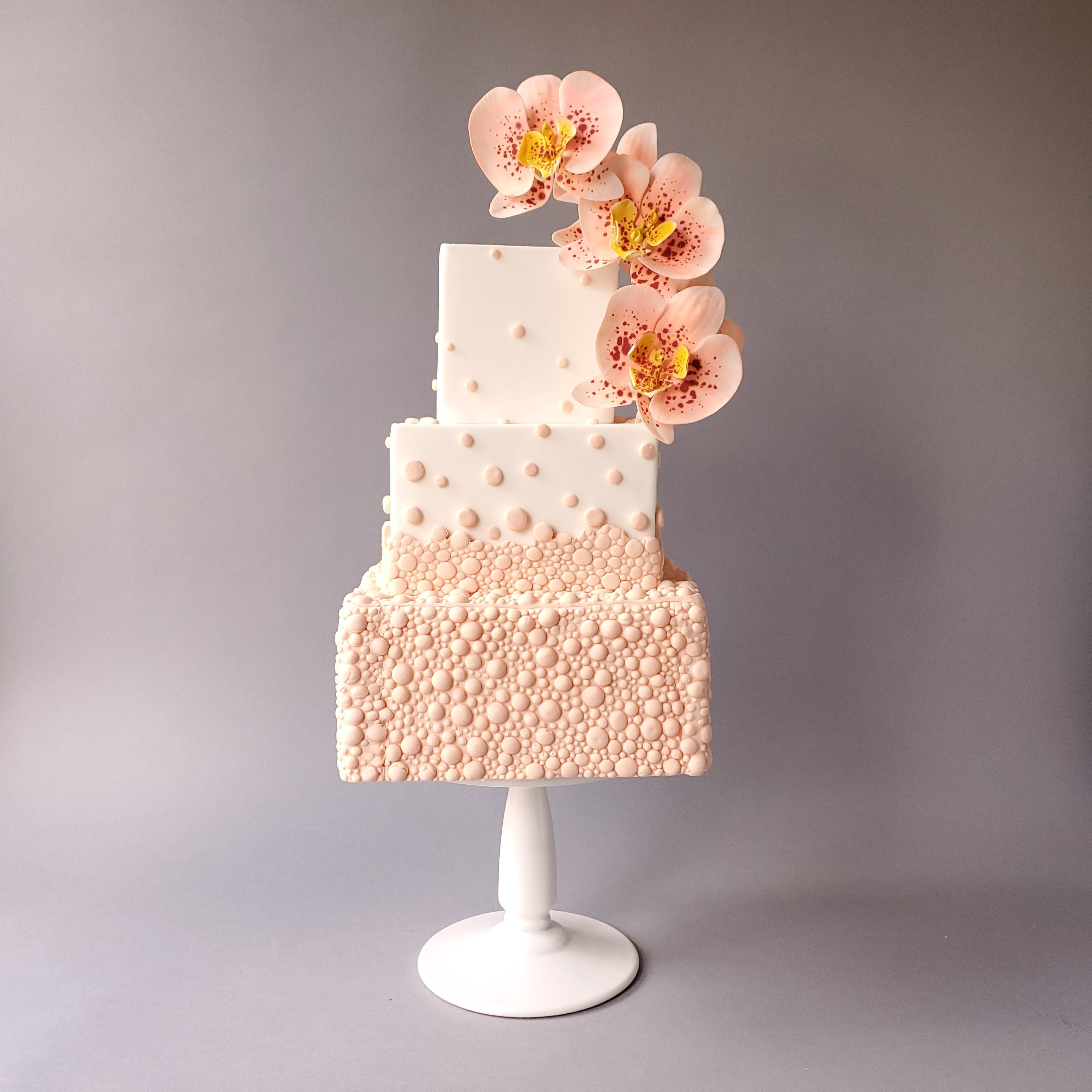 All peach wedding cake with peach sugar flowers