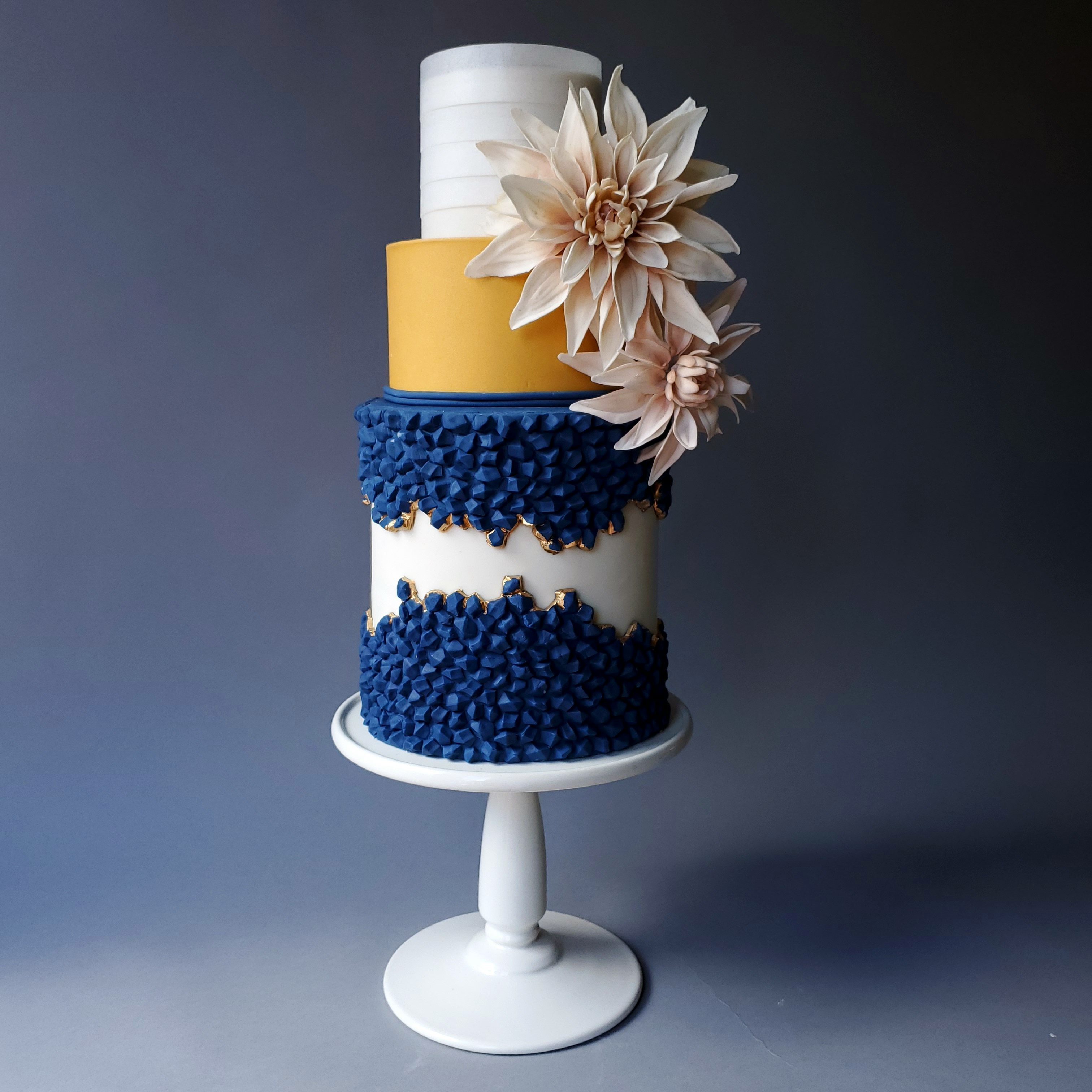 Navy blue and gold fault line cake