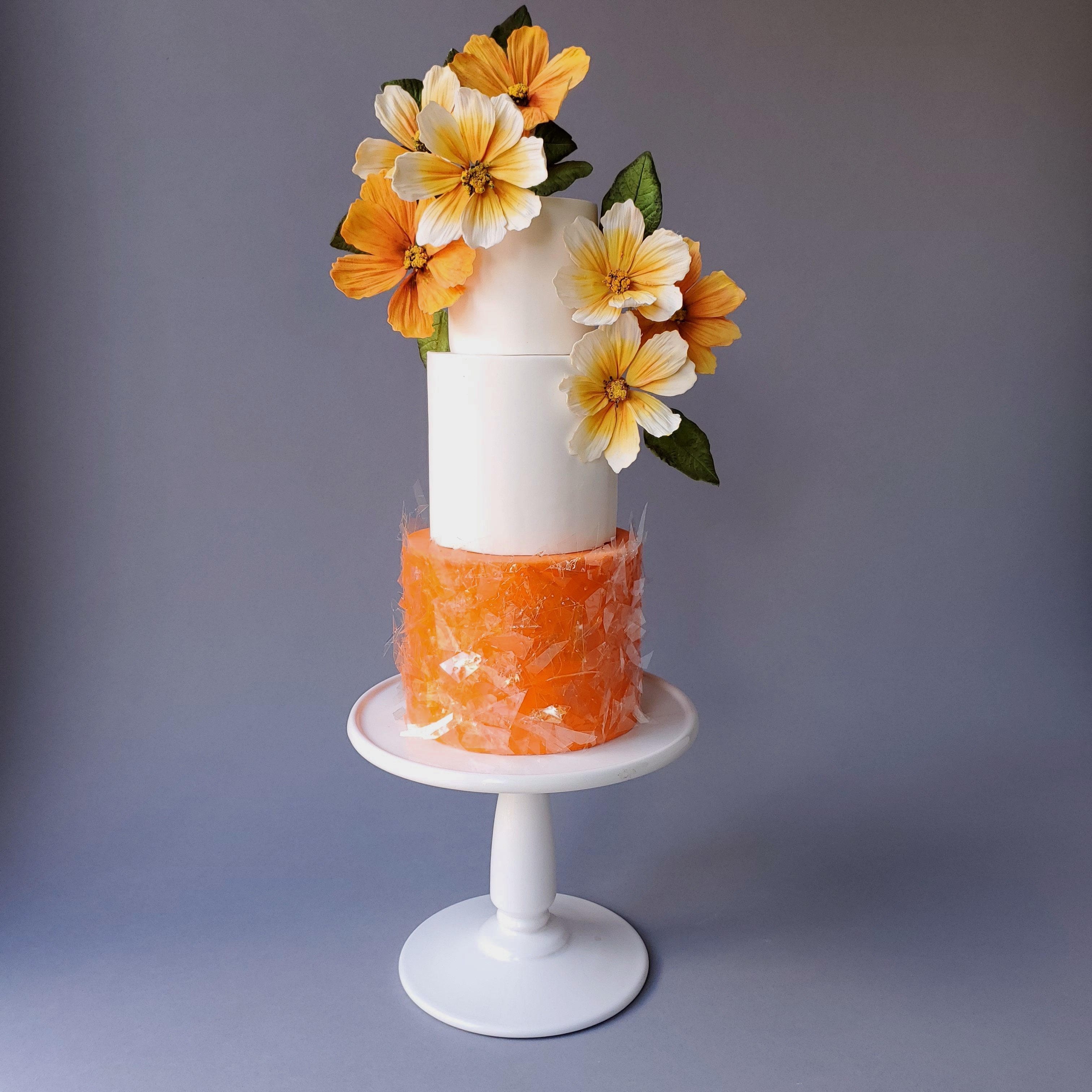 orange and white wedding cake with orange sugar flowers