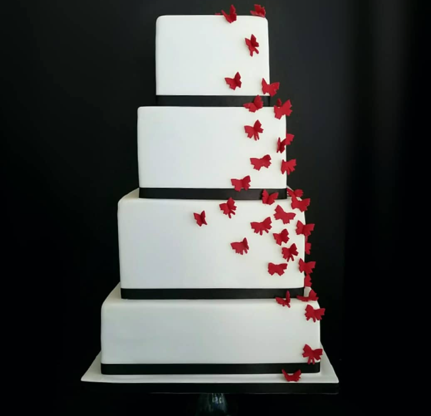 White fondant cake with tiny red hears