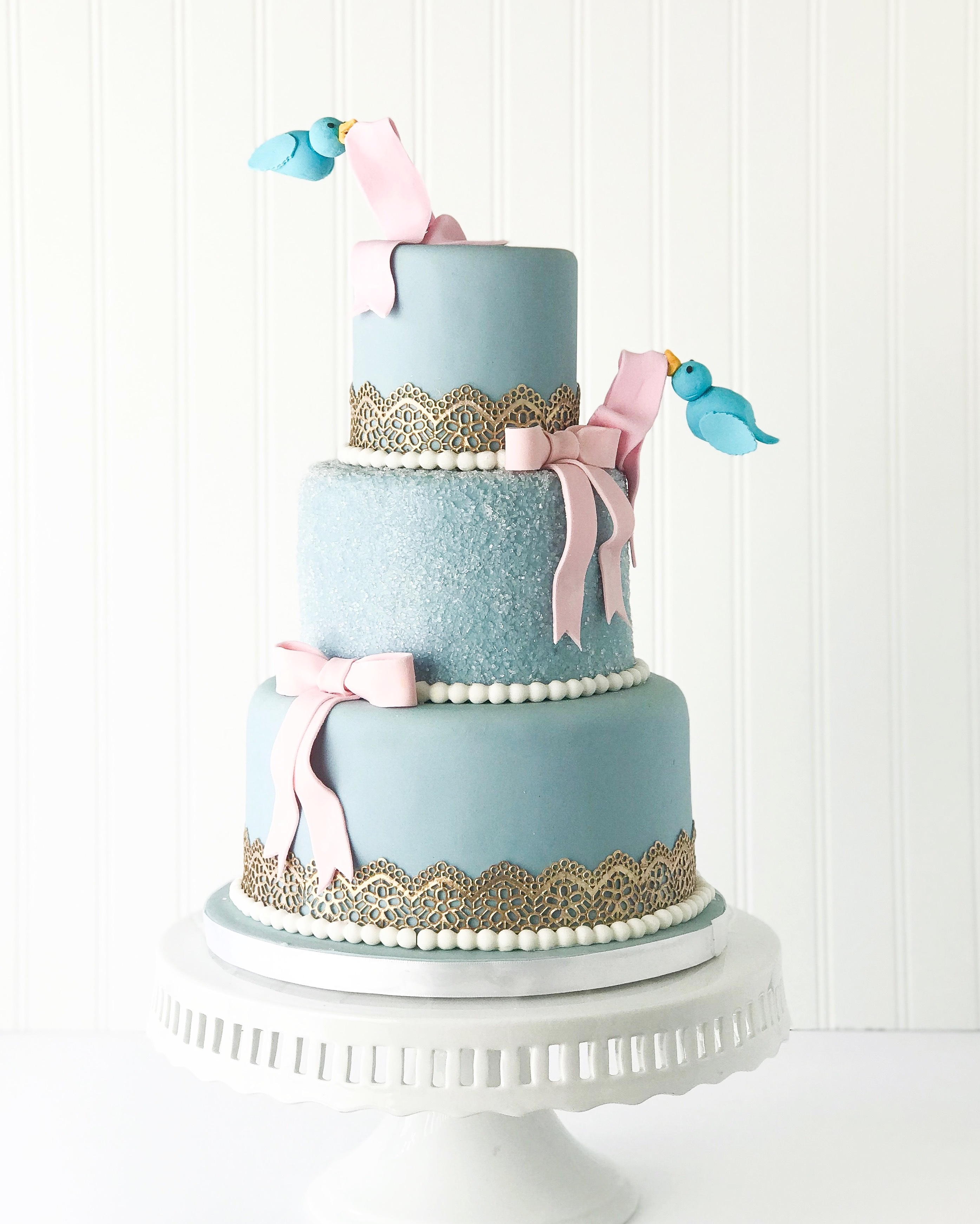 Baby blue fondant wedding cake with pink bows