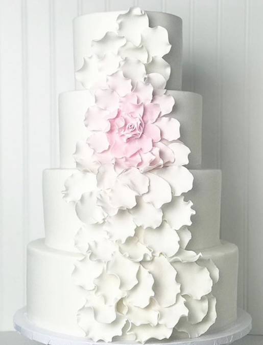All white fondant cake with center ruffles