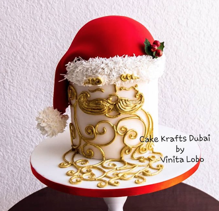 Santa Claus white fondant cake with gold detailing
