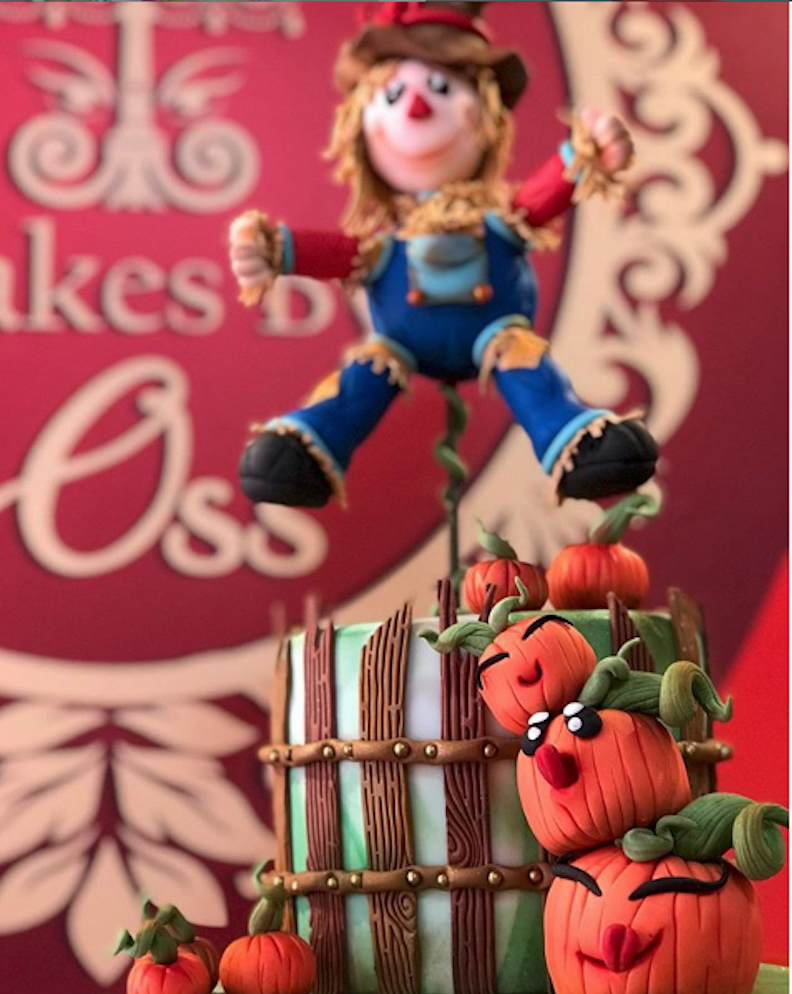 Scarecrow topper on fall cake