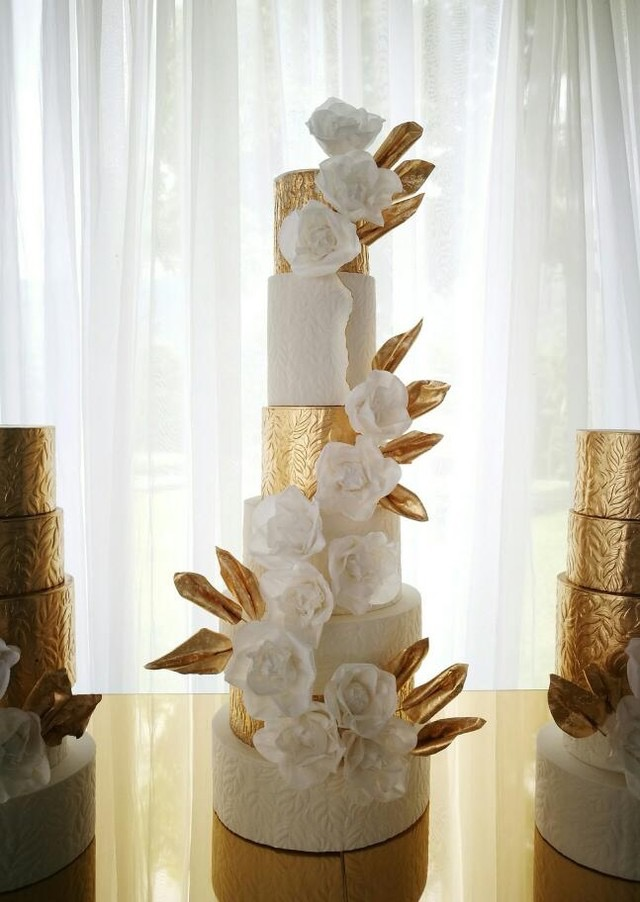 White and golf leaf wedding cake