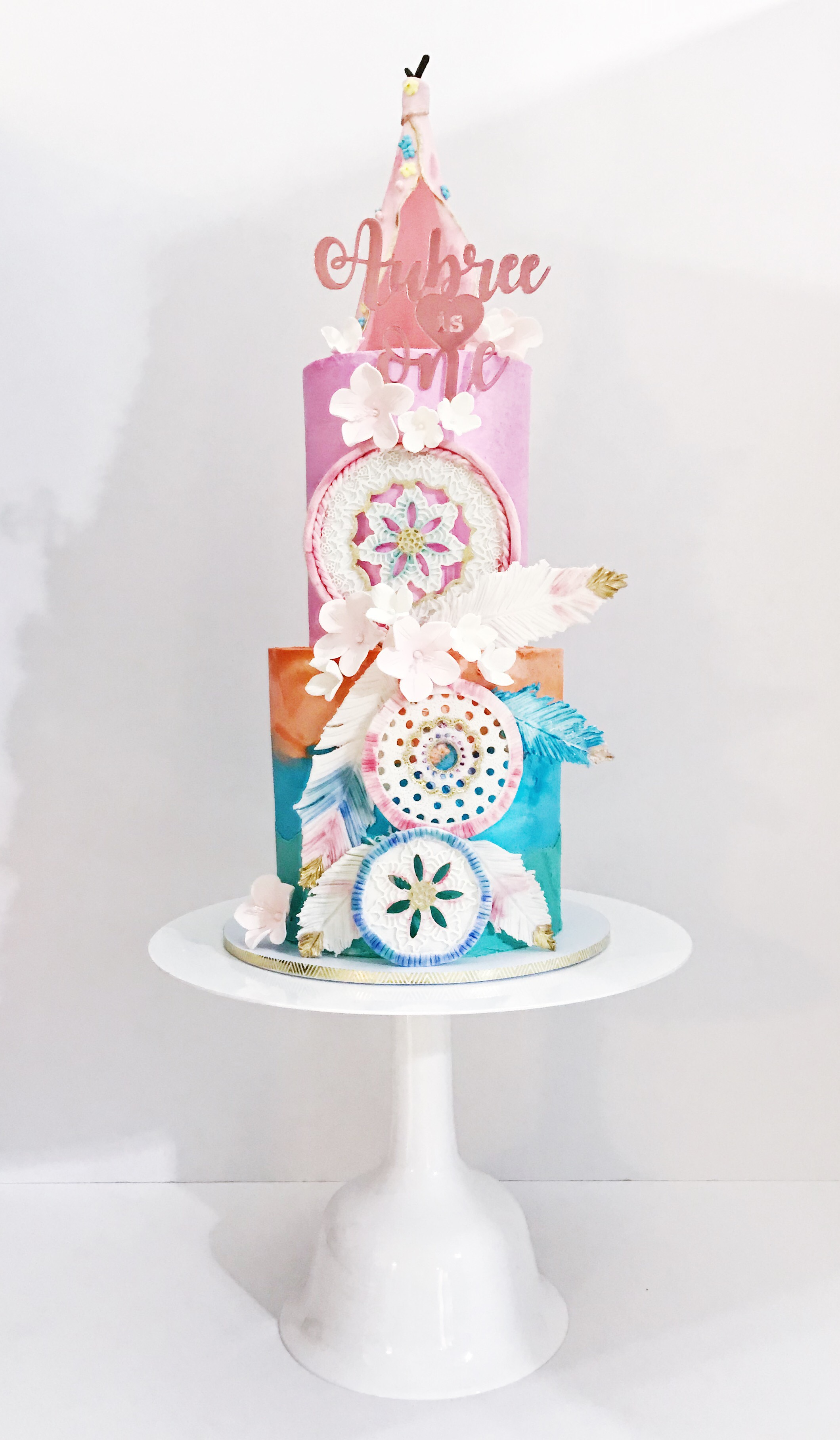 Pastel colored boho birthday cake