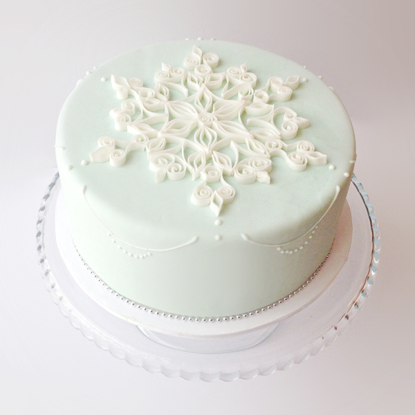 Light green fondant Cake with snowflake topper