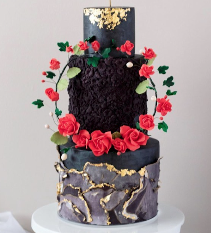 Black marbled fondant cake with bas relief