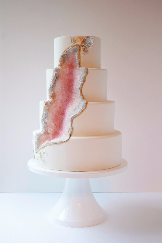Light pink fondant wedding cake with pink crystlas