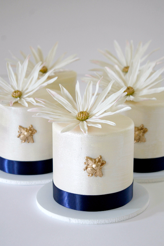 Tiny white  Cakes with sugar flowers