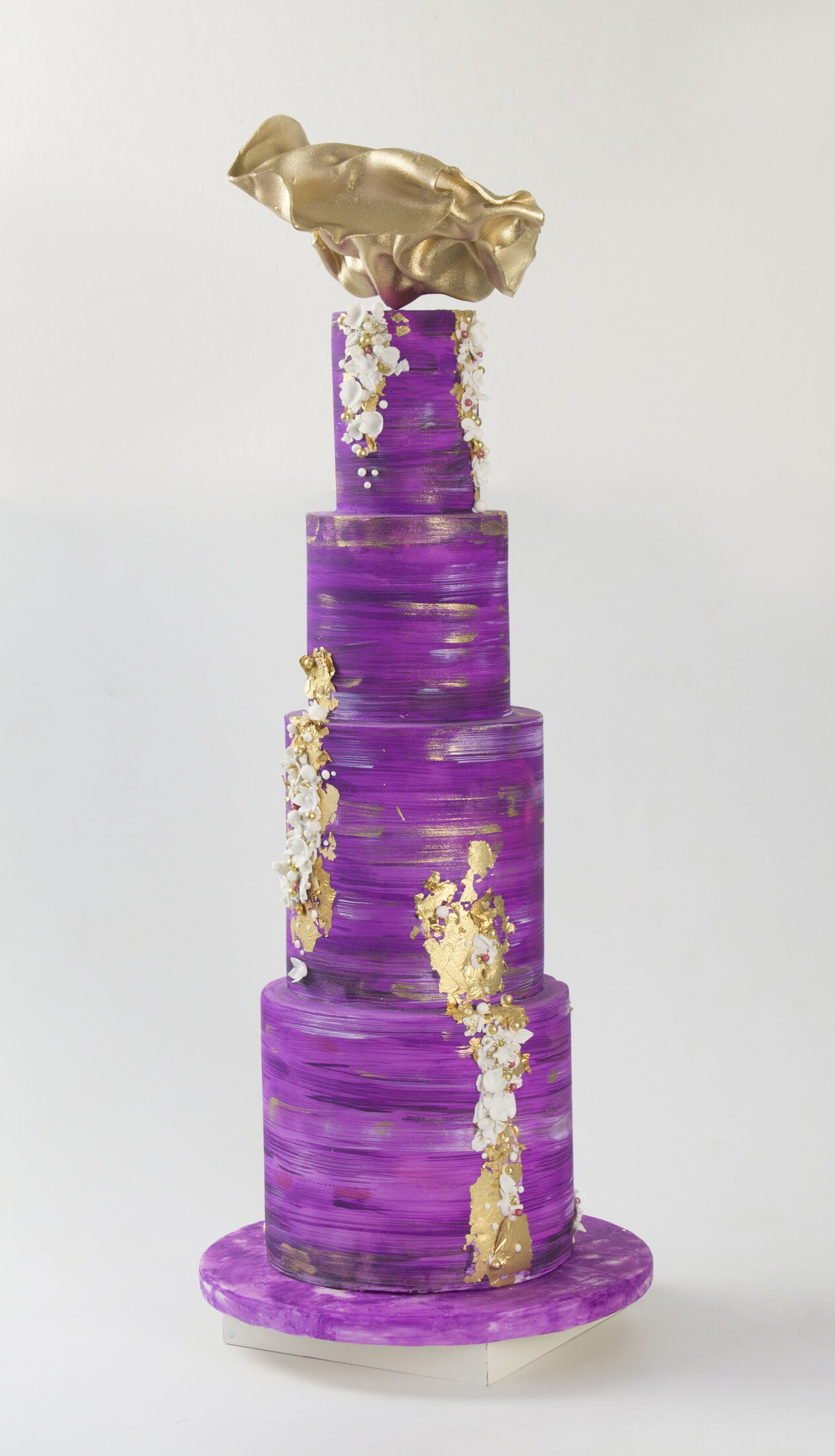 All purple wedding cake with gold leaf