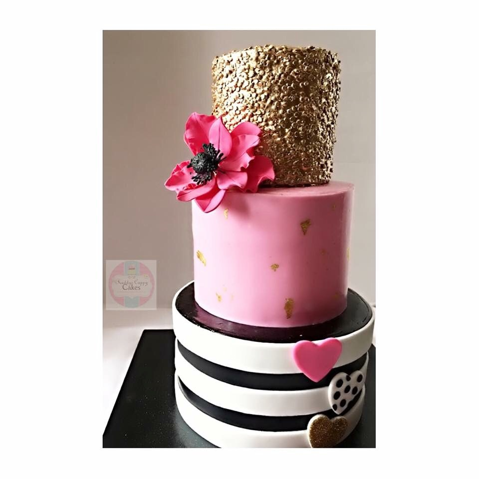 Striped birthday cake with gold sequins