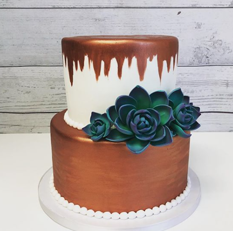White fondant wedding cake with copper chic