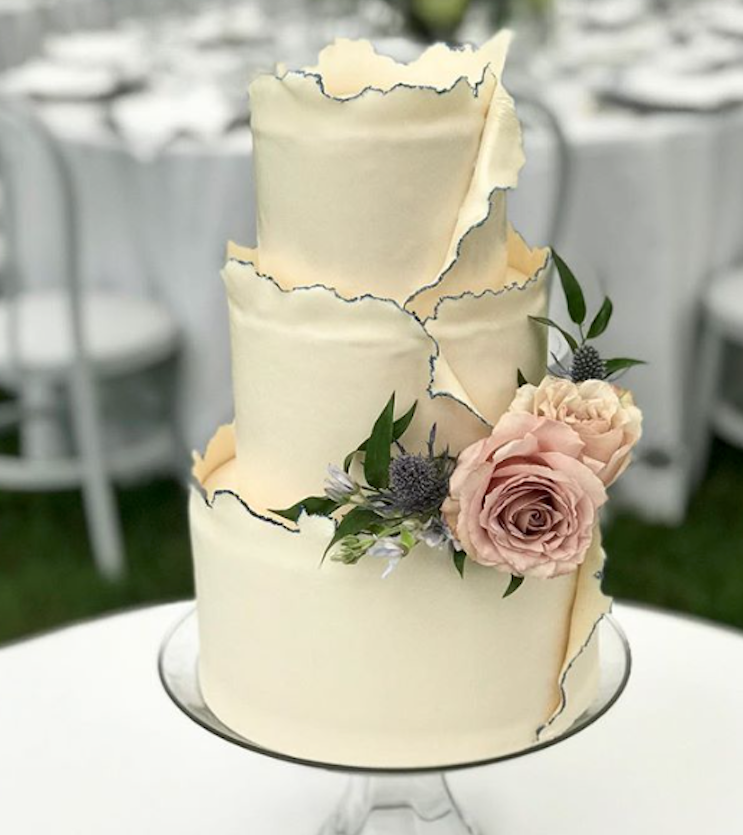 Ivory fondant wedding cake with gold trim