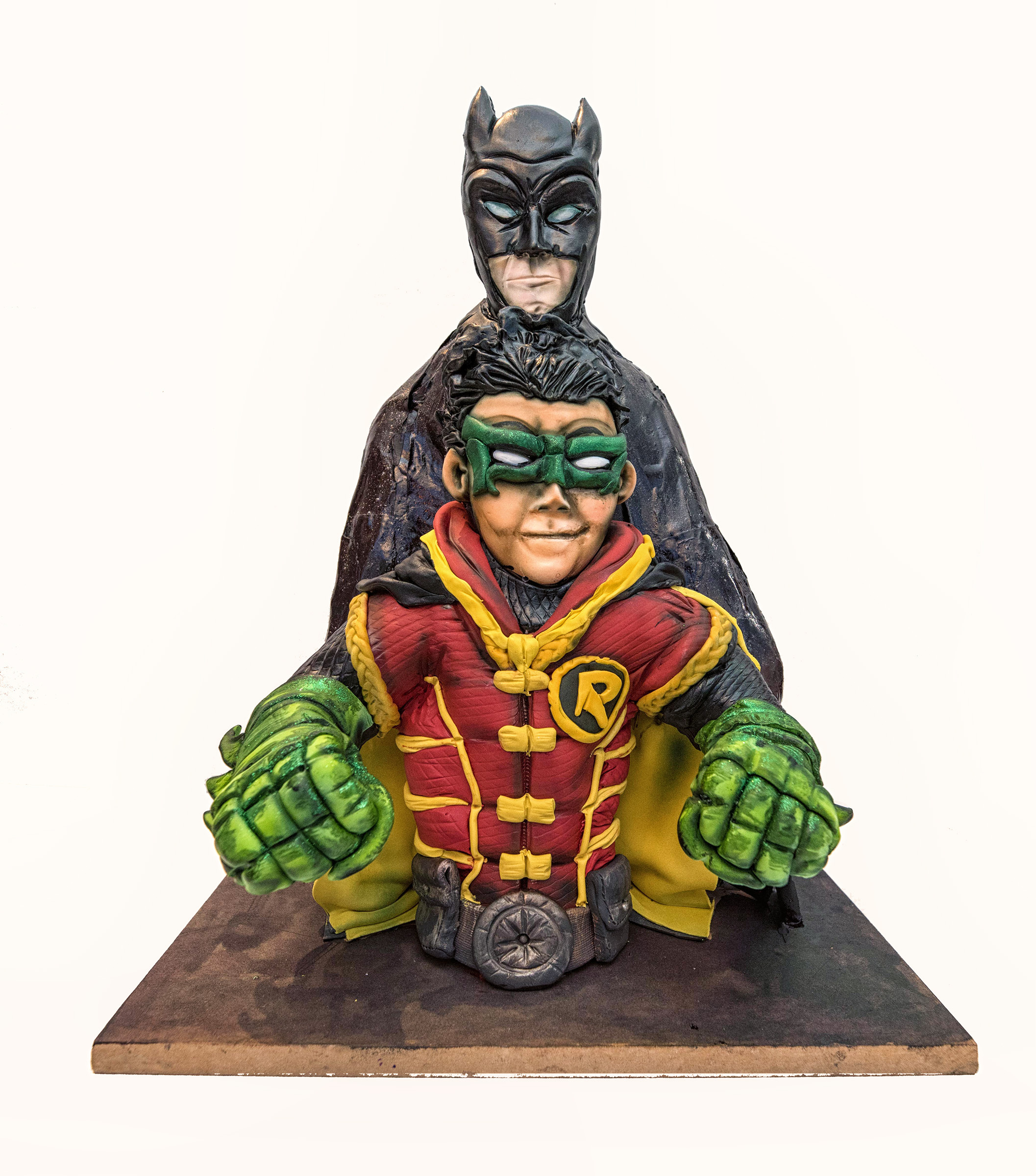 Batman and robin modeling chocolate bust cake